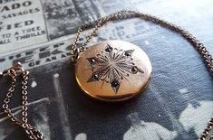 The small bee imprint inside this 1874 snowflake locket. | 14 Vintage Locket Details That Are Utterly Delightful
