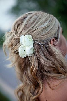 half up wedding hair, kind of messy, with flowers