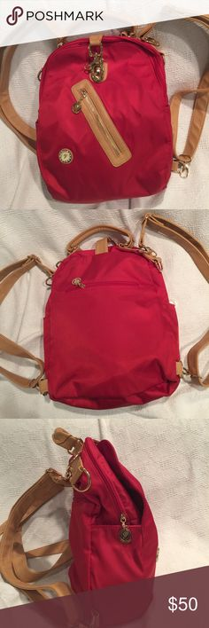 LOTINA RED NYLON BACKPACK WITH TAN STRAPS. LOTINA RED NYLON BACKPACK WITH GOLDTONE HARDWARE AND TAN STRAPS. POCKETS GALORE!! FIVE POCKETS ON THE OUTSIDE AND FOUR ON THE INSIDE. BEAUTIFUL AND MINT CONDITION! Lotina Bags Backpacks