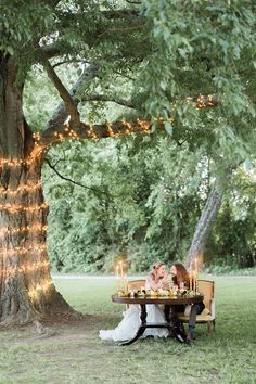 The prettiest sweetheart table I ever did see under the big hackberry tree at Waverly Estate.