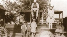 1920s—The children of Garret and Ettie Postema are on the truck of Garret's painting and decorating business. Seated on top is Henry. Others are Herman, John, Sarah, Winnie, and Anna.  Photos and facts courtesy of the Highland Historical Society.