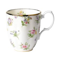 100 Years of Royal Albert 1950 Festival Mug, 14 ounces. The 1920 Spring Meadow Mug is decorated with a motif of primroses, roses, violets, harebells and forget-me-nots on a subtle cream colored background, accented with 9-carat gold trim throughout .