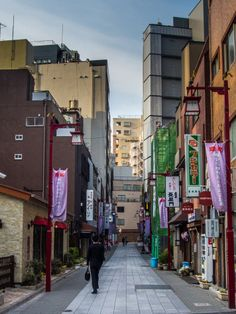 """A small alley right in the eastern entrance of Kaminarimon Dori/Street (i.e. from the Sumida River/Azumabashi Bridge) whose only purpose seems to be to act as a passage between the Ginza Line (exit 2) and the Asakusa Line (exit A4). But if you look closely to the lamp-posts, a grand name pops-up: """"Kaminarimon Ichinomiya Shotenkai"""" i.e. """"Most important shrine Business Association"""" What's going on? 1/3 Taken on April 2, 2014. © Grigoris A. Miliaresis"""