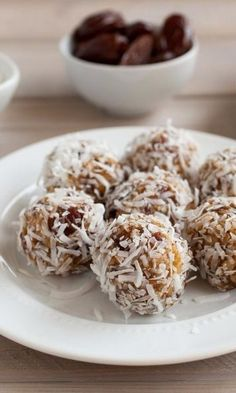 Coconut Date Balls are easy no bake cookies made with crispy rice cereal, chewy dates, and flaky coconut. Portable and popable, this super easy recipe is made in no time, making them a a quick and easy after school snack or sweet treat...especially during the holiday season. Serve them for Christmas or Thanksgiving for dessert or give them away as a homemade edible gift to someone you love.