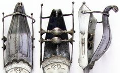 Indian hooded katar, detail view of the handle, 16th century, L. 19 3/4 in. (50.2 cm); W. 3 3/16 in. (8.1 cm); D. 4 in. (10.2 cm); Wt. 18.3 oz. (518.8 g), Met Museum, Bequest of George C. Stone, 1935.