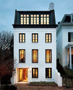 Georgetown House Painted white brick, black framed windows and modern Mansard roof--killer exterior Architecture Classique, Architecture Design, Classical Architecture, Architecture Career, Computer Architecture, Architecture Company, Beautiful Architecture, Residential Architecture, Landscape Architecture