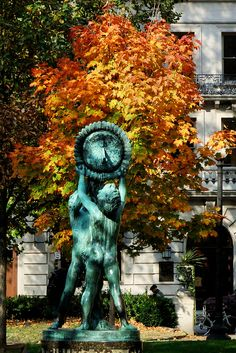 Sun dial statue in autumn, Rittenhouse Square Park, Philadelphia