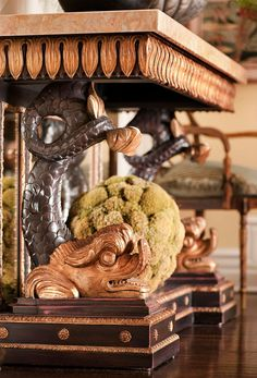 Look at the fantastical detailing of this French Empire console table. - Traditional Home ® / Photo: Mark Edward Harris and Michael McCreary / Design: Timothy Corrigan