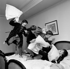 The Beatles -- from left, Paul McCartney, John Lennon, Ringo Starr and George Harrison -- letting off steam with a pillow fight. Harry Benson, Ringo Starr, John Lennon, George Harrison, Pop Rock, Rock And Roll, The Beatles, Beatles Photos, Classic Rock