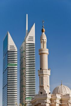 Towering   Minaret and skyscrapers in the city's skyline, Dubai, UAE
