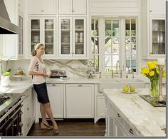 white, marble, double stacked cabinets, glass-front cabinets, double farmhouse sink, faucet, range, bay window, huge prep space, hardware