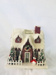 Red Retro Christmas Paper Mantel Village House with Snowman and Bottle Brush Trees Christmas Village Houses, Christmas Gingerbread House, Christmas Mantels, Christmas Villages, Victorian Christmas, Vintage Christmas, Putz Houses, Christmas Village Collections, Gingerbread Village