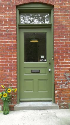 MOSNART's front door and transom window. Photo credit: JB Daniel