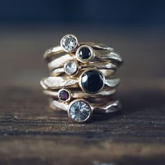 Stacked engagement rings by Andronyk Jewelry. Inspired by planetary geological formations.   #weddings #wedding #scifi #sciencefiction #planets #astronomy #geekweddings #ecoluxury #ecoluxe #luxury #yellowgold #blackdiamond #rosecut #diamond #conflictfree #ethical #recycledgold #sustainable #textured #marthastewartweddings #ido #shesaidyes #sparkle #flash