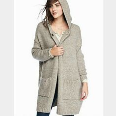 Free people hooded cardigan NWT Soft  cardigan with hood Snap closure at neck area. Super cozy.  Color.is light multi melange  (best shown pics 1,4) like a greyish beige combo of colors  Size xs  NWT $ 168  All prices are negotioable Bundle and save the most! Free People Sweaters Cardigans