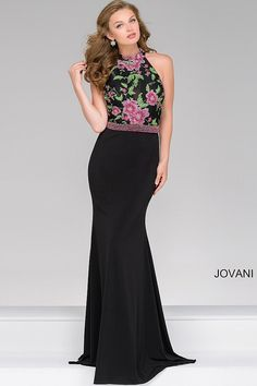 Sexy black floor length form fitting sleeveless jersey prom dress with multi color beaded bodice features high neckline and an open back.