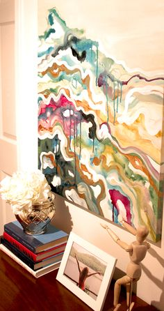 Wall art provides color inspiration for other decor elements in a space.