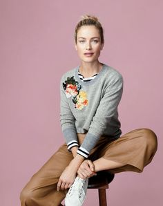 J.Crew women's herringbone sweater with floral patches, cropped pant and Tretorn® canvas T56 sneakers.