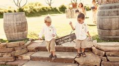 """Cute little boys holding """"Here comes the bride"""" rustic sign. So sweet!"""