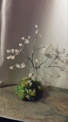 Rose quartz tree of life on a grassy bank by SpryHandcrafted on Etsy