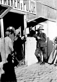 An Australian soldier outside a shop near the Australian camp at Port Said, Egypt, January 1918.