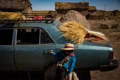 LLAPALLAPANI, BOLIVIA 5/4/2016 David Alejo Valero, 6, with hay for hat making. Many of the town's people lost their livelihoods when a nearby lake disappeared, done in by the warming effects of climate change. Josh Haner/The New York Times