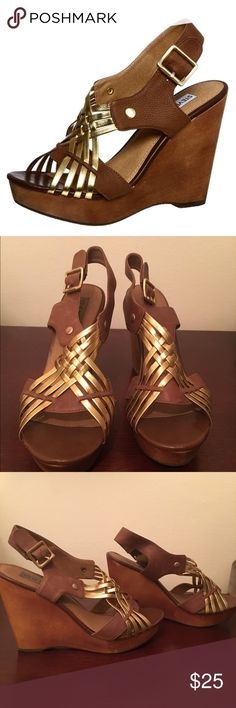"""Steve Madden Brown and Gold Turnpyke Wedges Steve Madden brown and gold Turnpyke wedges. Slight scuffs from storage and wear but overall excellent condition. Approx. 4"""" heel, 1"""" platform. Imported. Materials: leather upper. Worn once.   🎉20% discount on all bundles🎉 ❌No trades❌ Steve Madden Shoes Wedges"""