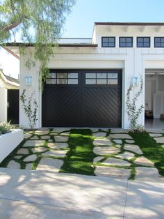 Transform and update the exterior of your home instantly by replacing garage doors with a more modern garage door design. We're showing you garage door styles to consider and what you need to think about when choosing modern garage door designs. Black Garage Doors, Modern Garage Doors, Garage Door Design, Garage Exterior, Garage Door With Windows, Garage Door Colors, Wood Garage Doors, Exterior Paint, Black Exterior Doors