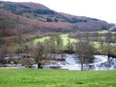 Walk beside the scenic Horseshoe Falls close to Llangollen in North Wales. https://www.qualitycottages.co.uk/aroundwales/horseshoe-pass-horseshoe-falls-velvet-hill