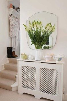 Use these radiator cover ideas to transform your room. See how to use a radiator cover for storage, reading nooks under windows, corner cabinets + more. Shabby Home, Shabby Chic, Sofa Bed Mattress, Radiator Cover, Radiator Screen, Radiator Shelf, Small Hallways, Decoration Design, Hallway Decorating
