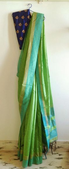 Parrot green semi raw silk saree withblue and gold border and