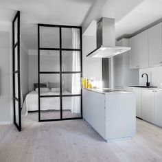 Ohhhh check out this stunning apartment currently accepting bids in by in Stockholm. the metal – glass doors into the bedroom den and the sleek open concept kitchen. Someone buy it already! Studio Apartment Layout, Small Apartment Interior, Condo Interior, Studio Apartment Decorating, Interior Design Living Room, Casa Loft, Tiny Apartments, Home Decor Kitchen, House Rooms