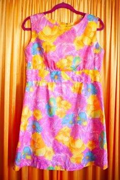A vintage bright pink, yellow, purple and blue sleeveless mini mod dress with a floral print. Has a high round neckline, a high pleated waistband underneath the chest and a zip up the back as fastening. Orange And Purple, Pink Yellow, Bright Pink, Blue And White, Mod Dress, Purple Dress, Size 10, Neckline, Zip