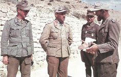 Generalmajor Fritz Bayerlein (Chef des Generalstabes 1. italienische Armee) with the officers of the German Afrikakorps in North Africa, spring 1943. From left to right: an unidentified Leutnant, Bayerlein, Sonderführer Dr. Ernst Franz (Rommel's translator), and the bearded Sonderführer Fritz Moosmüller (a Propaganda official but spend most of his time as a Dolmetscher/translat