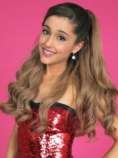 Ariana Grande's Half-Up 'Do. Use a large barrel iron to curl your hair, curling all sections in the same direction. Pull the top half of your hair up into a ponytail, smoothing with a paddle brush and leaving the bang section loose. Finally, pin the fringe behind your ear and spritz all over with hairspray!