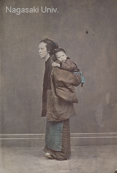 "The woman with a child on her back is wearing a ""hanten"" (half-coat), a garment worn commonly by both men and women from the Edo Period. She is also wearing an apron so that her kimono will not get dirty. About 1880's by photographer Usui Shuzaburo"