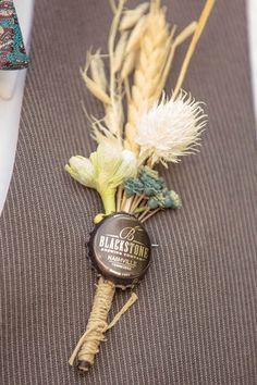 DIY Vintage Boutonnieres created from vintage-inspired bottle caps, a colorful mix of masculine flowers and twine ♥