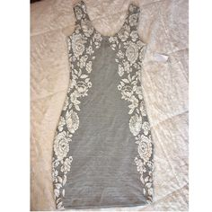 Gray/White Flower Printed Bodycon Dress Flower printed bodycon dress. Beautiful design. So soft and lightweight🔹Material: 54% cotton 45% polyester 1% spandex 🔻No trades🔺 Charlotte Russe Dresses
