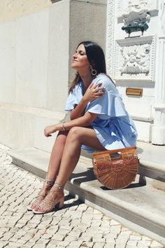 #Summer #outfit wearing romantic blue dress, wood bag and beige sandals. #Style #fashion