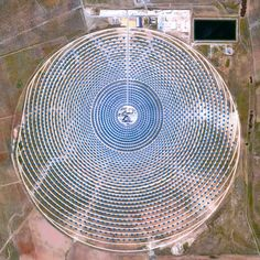 The mighty Gemasolar Thermosolar Plant in Seville, Spain, focuses mirrors to generate green electricity. Satellite Images Reveal Humanity's Mighty Impact, for Better or Worse - CityLab Thermal Energy, Advantages Of Solar Energy, Earth And Space Science, Eden Project, Climate Change Effects, Human Condition, Aerial Photography, Seville Spain, Kansas City
