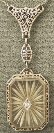 Art Deco 14K Gold, Diamond Camphor Glass Pendant Necklace. Via Diamonds in the Library.