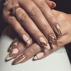 Gorgeous nude and gold almond long nails