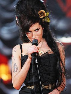 "Grammys Moments That (Almost!) Broke the Internet | AMY WINS 'EM ALL | 2008 was the year of Amy Winehouse, whose breakthrough album Back to Black swept the Grammys with five trophies. Even more emotional than her wins was her shout-out to her troubled husband: ""To my Blake, my Blake incarcerated."""