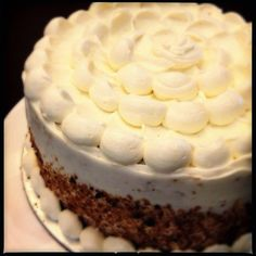 Pandan cake with piped flower -frosting is a coconut cream cheese with whipped cream and a Gula Melaka streusel middle.