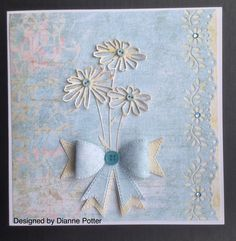 By Dianne Potter: Memory Box Glorious Gerber Daisy die,Sue Wilson Classic Bow die,Martha Stewart floral punch.Papers from Winter Wishes from First Edition Papers,buttons from Gorjuss and Trimits Crafts......