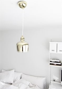 the GOLDEN BELL lamp and white sheets