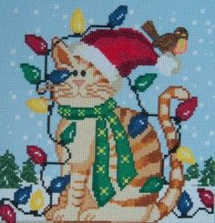 """Christmas Kitty"" is the title of this cross stitch pattern with a Christmas kitty all tangled up in lights and a cute bird perched on his c..."