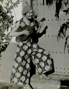 Catherine Moylan strums a Martin uke. Circa 1930.