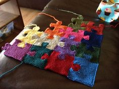 Puzzle piece knitted blanket. Portion of the price for the pattern goes to Autism Speaks.