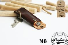 "Handmade Leather USB Holder Keychain. This item can be customized in different colors and with initials engraving.  Protect your important information!  Measure  3.34""x1.4""..."
